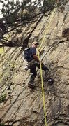 Joe Jenson on rappel checking the route during initial development of Beginners Luck
