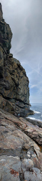 Vertical Panorama of climber deliberating how not to deck on his next attempt to make the second clip.