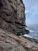 Rock Climbing Photo: Climber on starting ledge of Sinbad, first bolt cl...