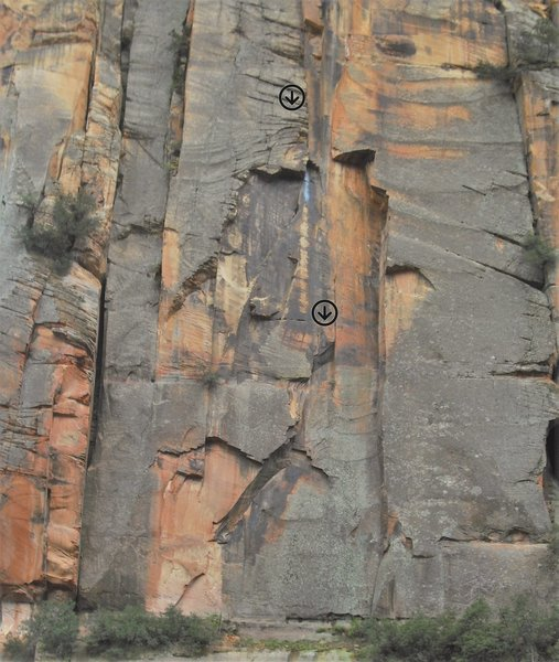 The lower part of Valhalla follows the right leaning crack then up the patina past the metallic varnish to the crack.