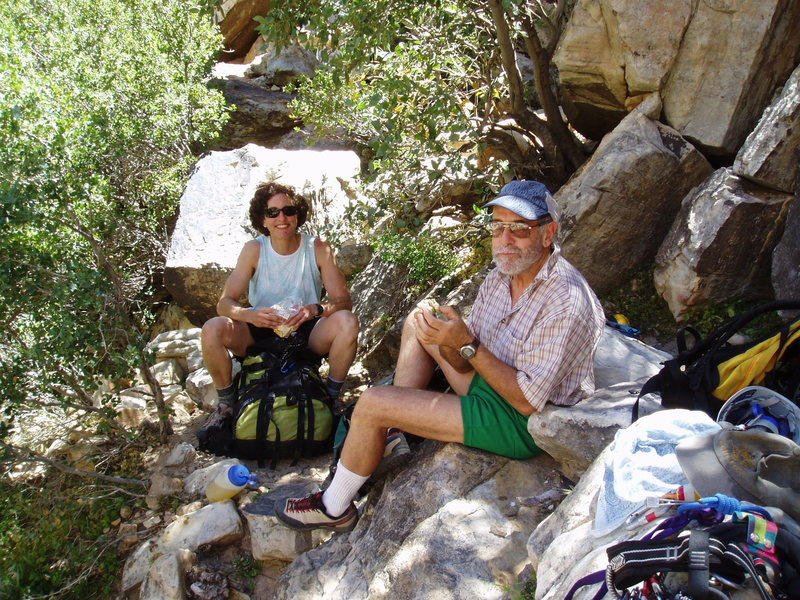 S. Matz & J. Urioste wait in the shade for Lotta Balls to go into the shade and cool down a bit. May 2005