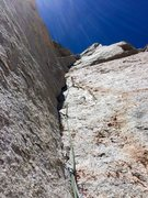 Rock Climbing Photo: RS stemming up in the crux, P3. Pic:NB