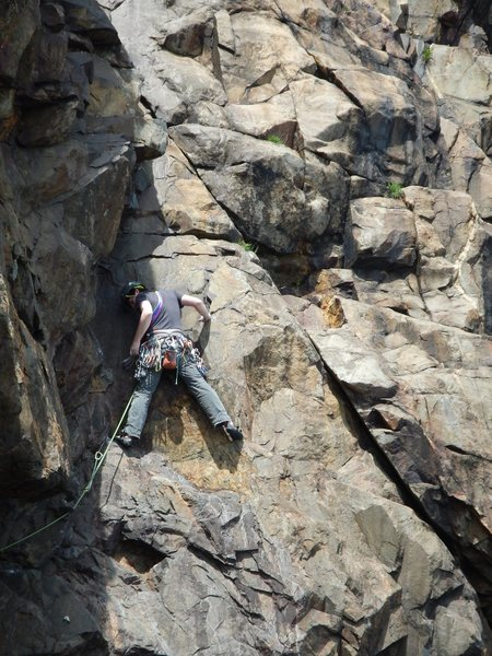 Daniel Kaye a little above crux. Single bolt (not clipped) visible in bottom left. Climb continues up and slightly left from this point.