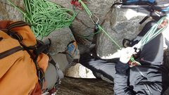 Belaying on top of the chockstone in the 4th pitch chimney.