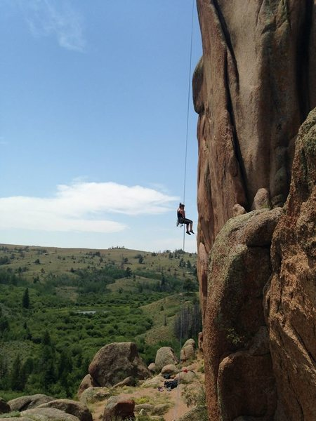 Repelling off a trad chimney in Vedauwoo, Wyoming