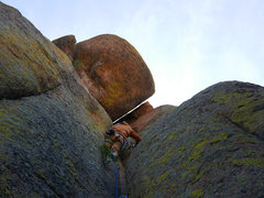 Rock Climbing Photo: Squeeze through the narrow slot above or traverse ...