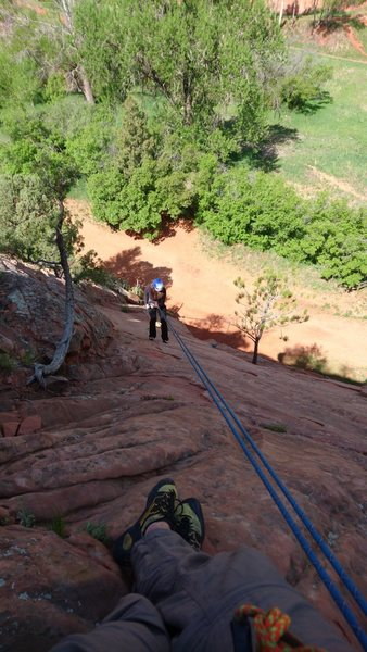 Looking down from the anchors on Billy&@POUND@39@SEMICOLON@s Ghost Dance. You can see the ripples in the sandstone that make this an easy and fun climb.