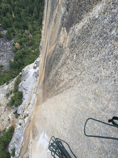 Looking down pitch 5 at the reachy bolt ladder. That's one blank steep face!