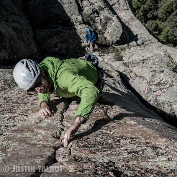 Josh Alford laughing his way up the left 5.7 crack just below the Summit Dome. This crack and the fun 5.7 crack just to the right are fun extensions to the Nose.