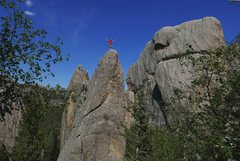 Rock Climbing Photo: Aaron Costello standing atop Riddle.