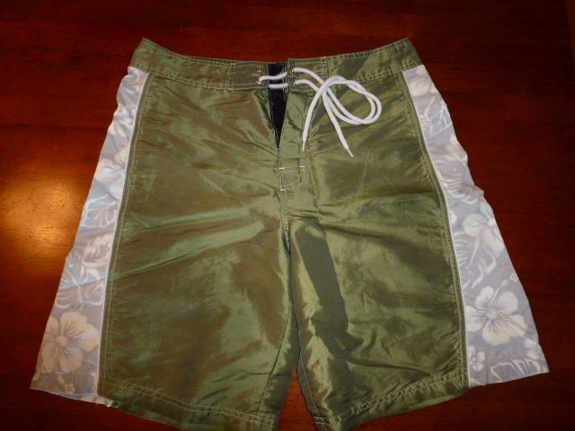 No name surf shorts - size 32. Free with purchase. 2 small drainage grommets on rear velcro pocket fell out, but they are otherwise in good shape and totally usable.