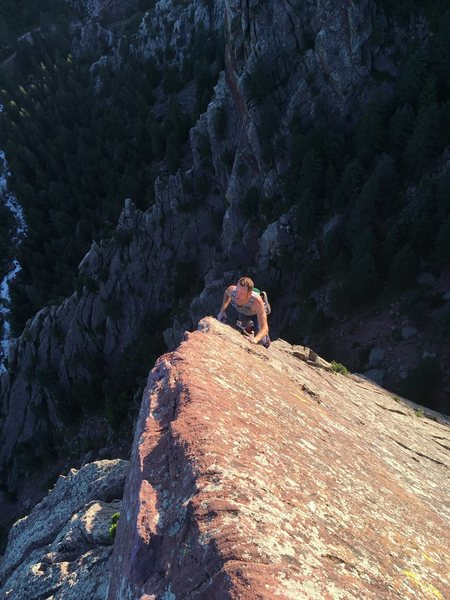 Michal solo on the finishing arete of Icarus, Tower One summit.