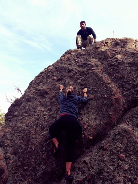 Janelle takes on West side of<br> No Approach Boulder.