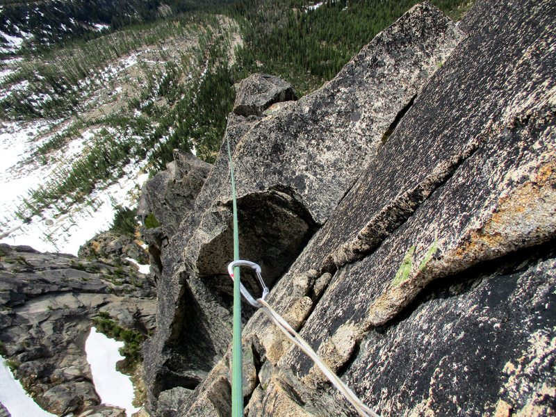 Looking down while leading Pitch 6 of Paisano. It's easy to generate a lot of rope drag on this pitch so I ran it out on easy terrain.