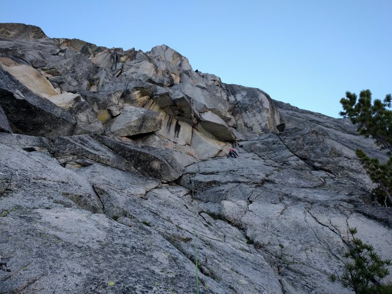 Pitch 1. Plenty of options on the slab lead to steep climbing in the corner.