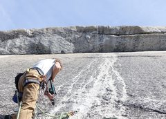 Rock Climbing Photo: Betsy Grant drilling second anchor bolt under the ...