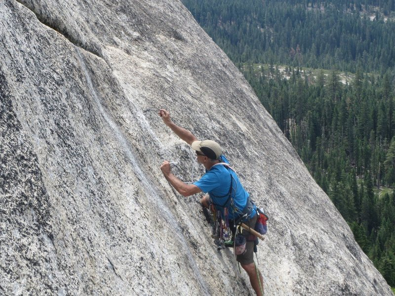 Rock Climbing Photo: Ney Grant wirebrushing a new bolt hole on the FA o...