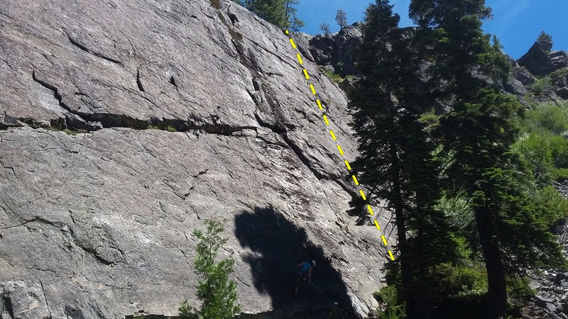 "The climber being lowered is on the ""[[108765735]]"" El Squatchito is the route 20' right of the black streak."