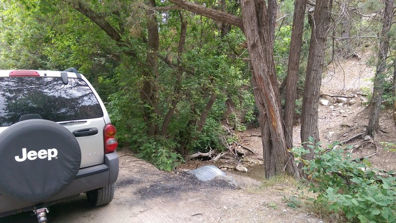 This is the parking area. It is after the &quot@SEMICOLON@Road narrows&quot@SEMICOLON@ sign on the left hand sign. You&@POUND@39@SEMICOLON@ll be parking right on top of a storm drain that goes into the creek.
