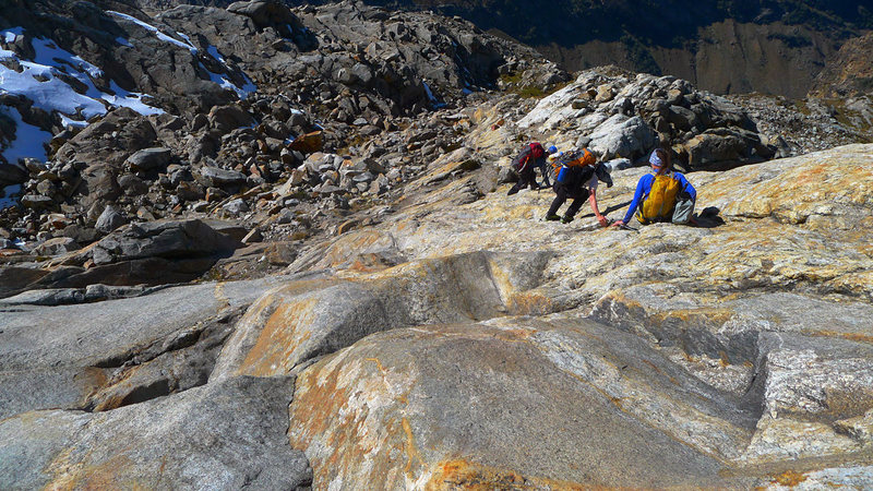 Descending the beautiful slabs below the glacier.