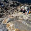 Descending the beautiful slabs below the glacier.