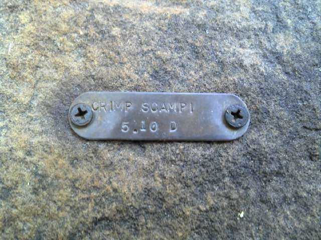 Crimp Scampi 5.10d brass plate route tag at Horseshoe Canyon Ranch in AR.