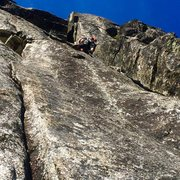 Sam leading up awesome granite with the squeeze/offwidth looming above.