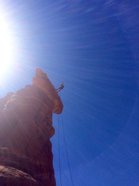 Starting the 80-foot free-hanging rappel down the north side of Kachina Woman.