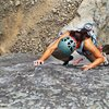 """Emily heading to the second clip on the """"slabbier"""" part of the climb."""