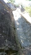 Route ascends left facing corner, then continues on slabbier terrain. Technical crux near the chains protected by a bolt.