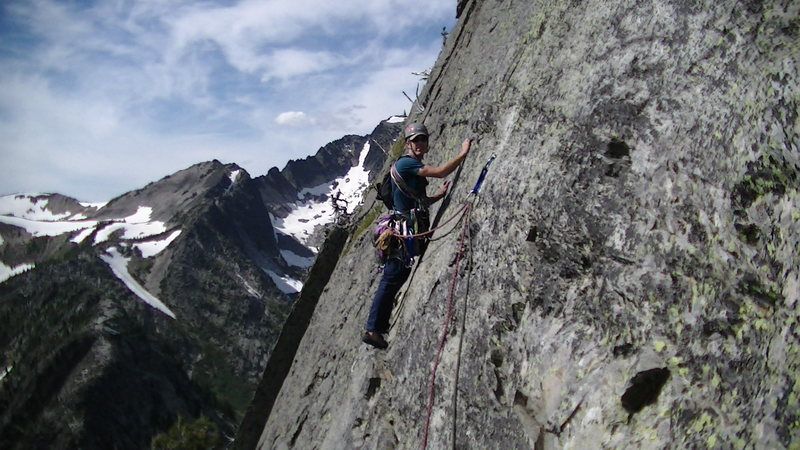 Rock Climbing Photo: Jeremy leading out the 5th traverse pitch, with th...