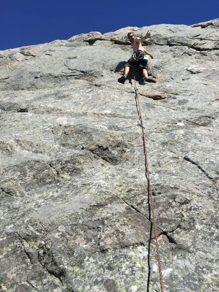 Warren Schaefer chills out resting on Gorillaglass, an awesome easy warm up at Flatanger.