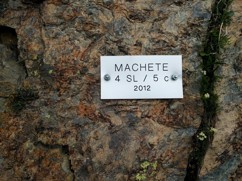 Plaque for Machete (5c).  This appears to be a new climb, and is not yet in the (excellent) Filidor Plaisir book.  GPS location 45.98067 N, 7.76082 E.
