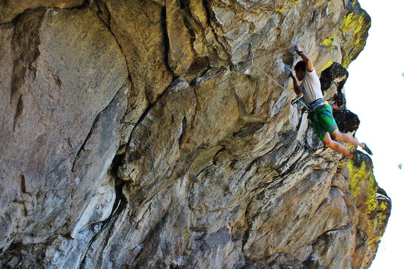 "Yusuke Komai on the crux move of before sending ""Totally Chawsome""."