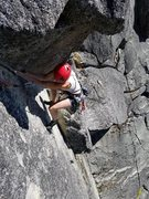 The finishing moves on the Second Pitch of Straight Street. Airy undercling with great exposure.