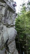 """Leading """"Missing the Taco"""" 5.10b. Climber is past the crux."""