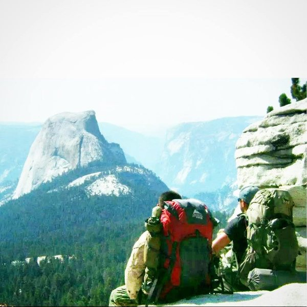 Backpacking with my cousin from Tuolumne meadows to the valley. We were coming down off of Clouds Rest and were standing on Half Dome the next day.