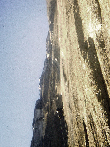 FA Mescalito 1973@SEMICOLON@ Near the middle of the route. The water streak to the arch to the ledge to the Bismark. Hugh or Charlie in the photo.