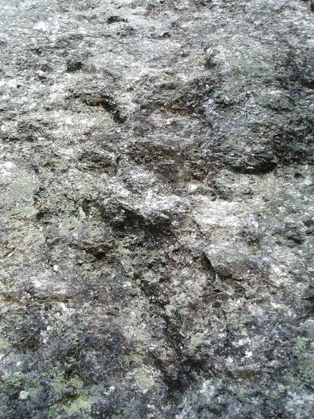 A close-up of pegmatite - difficult to see bolts with all that embedded mica