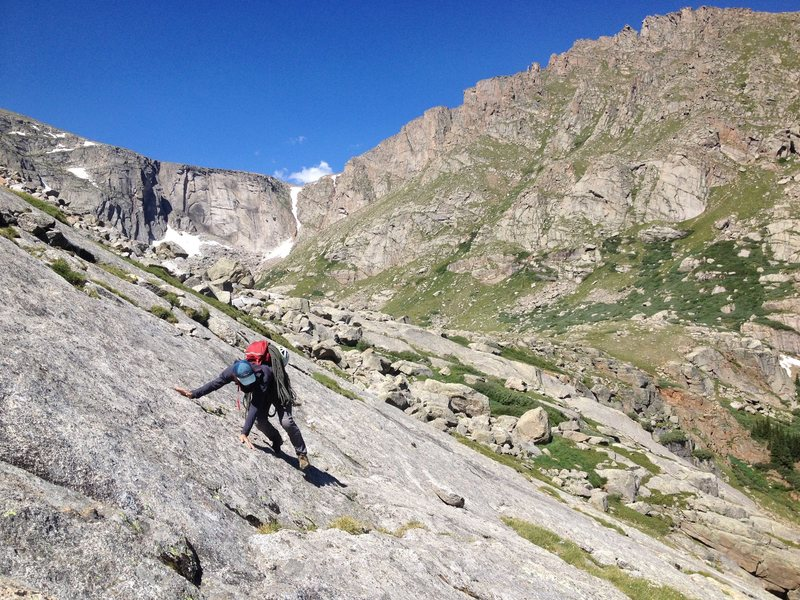 Alex approaching the Alpine Lite Cliffs via the large slab.