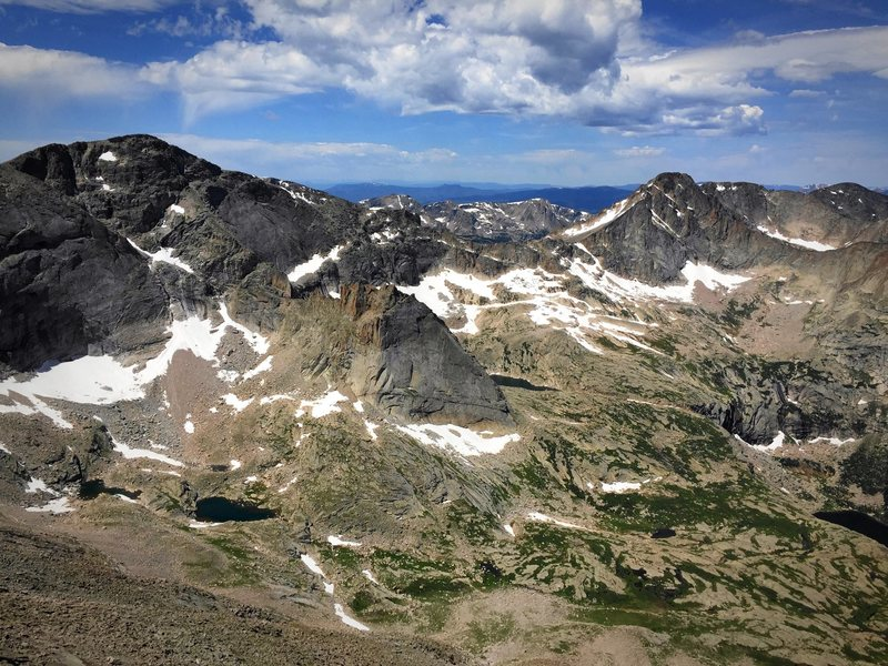 Looking west into Glacier Gorge. Taken from the west face of Long's Peak. Chiefshead, Spearhead, and McHenry's Peak (left to right).