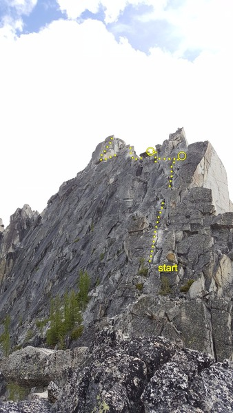 Prusik Peak west ridge from just N of Prusik Pass. The climb begins in the obvious lighter-colored crack. Our approximate line shown, with belays used. Turned around at crux slab so don't have belays beyond here.