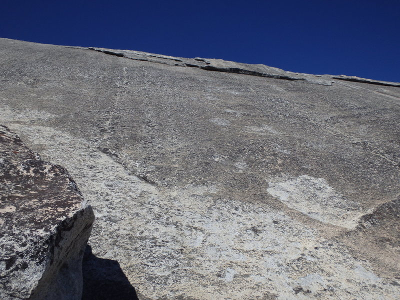 Looking up at P2. You can see the lone bolt on the face before the flake climbing. This is the view from the 1st belay station at the sandy ledge.