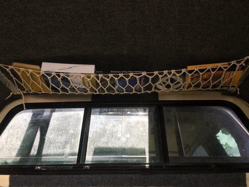 Hand strung cargo net