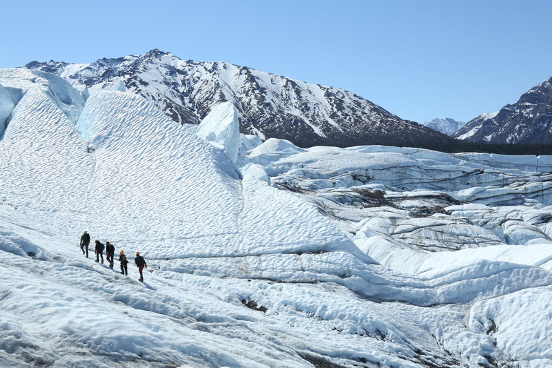 Group hiking up toward the top of the icefall