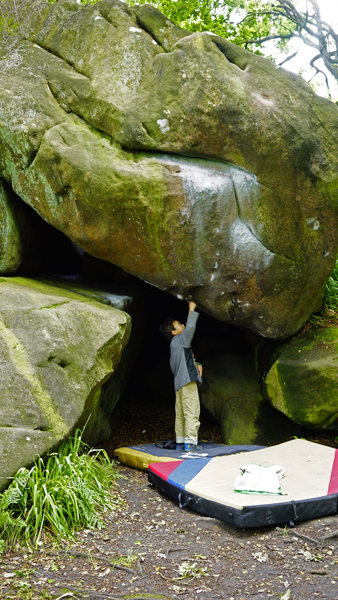 Rock Climbing Photo: My son, Dylan, brushing holds for me.