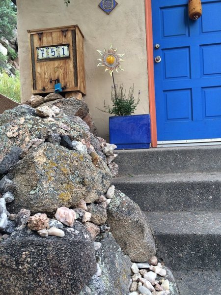 Front door, custom rock entryway built with stone from the property and a few other places around the world.