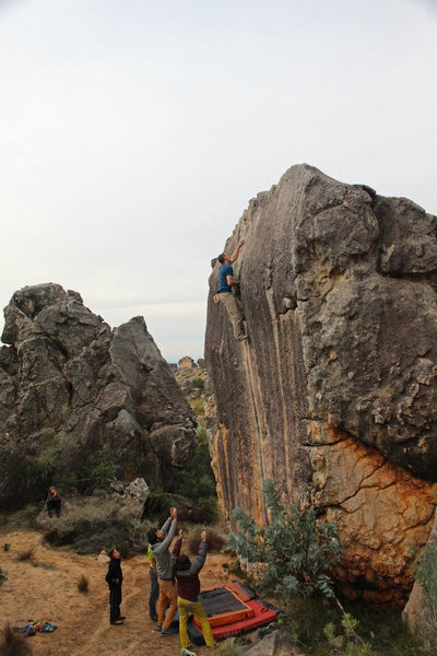 Making the easier transition onto the lower angle rock just short of the top, photo by Craig Faulhaber.