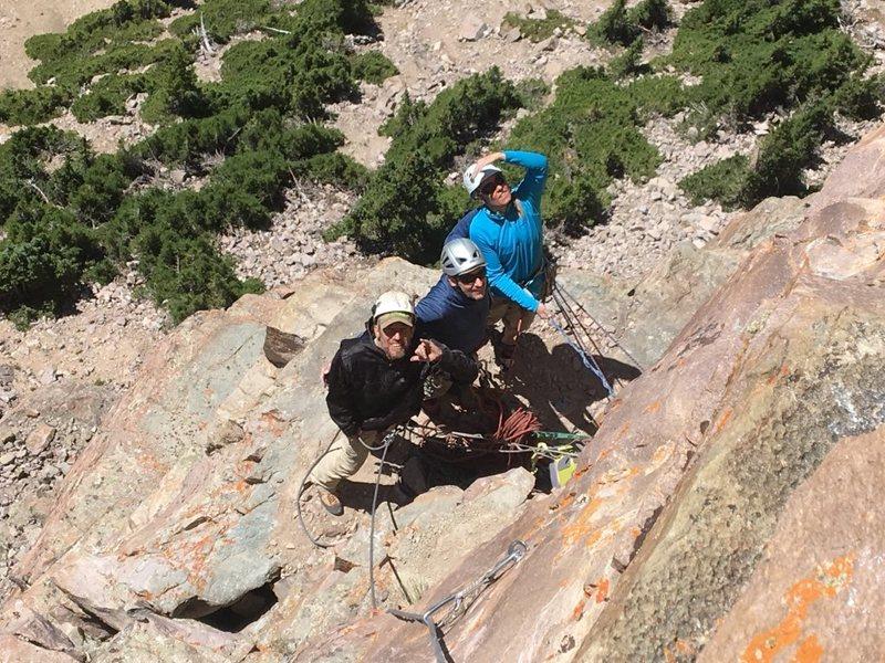 Site developers Craig (Rudy) Martin, Jersey Dave Littman, and Julia Salmi on a large belay ledge
