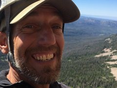 FA Jersey Dave Littman smiling a the belay!